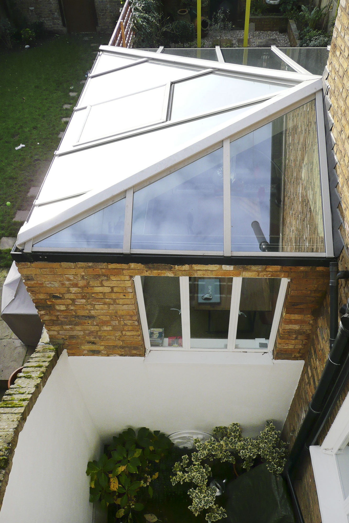 - marchini-architecture.com, - Clapham, - rear extension, -Crittall windows, - glass roof, - garden room, - patent glazing, - lightwell