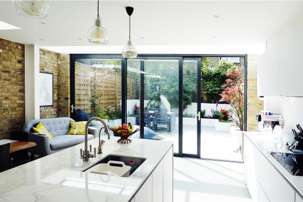 - marchini-architecture.com, - Balham, - rear extension, - side extension, - internal brick wall, - marble kitchen island, - sliding doors, - contemporary garden