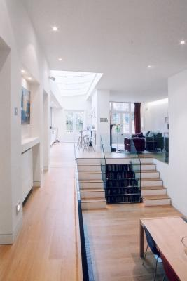 - marchini-architecture.com, - Barnes, - basement extension, - glass railing, - contemporary staircase, - skylight, - sunken dining area