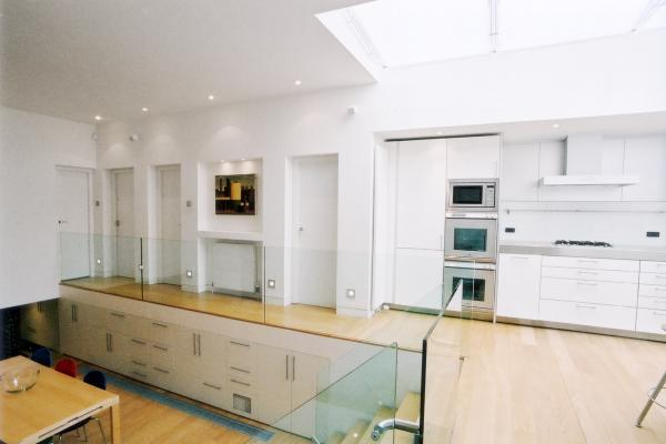 - marchini-architecture.com, - Barnes, - basement extension, - glass railing, - contemporary staircase, - contemporary interior, - Bulthaup kitchen, - contemporary skylight